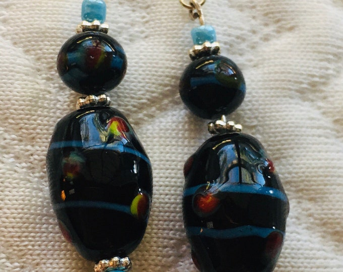 Black Lampworks wtri-Colored beaded dangle earrings with blue seed beads