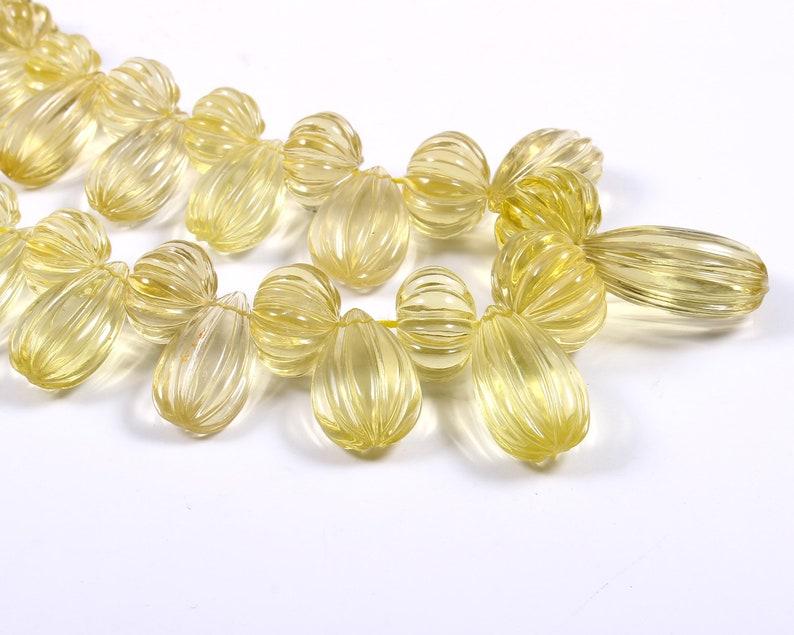 Natural Lemon quartz shape almonds /& muskmelon carving gemstone hand carved 33 pcs size 28x16x11 to 10x10x8 mm k-220 weight 431 crt