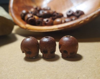 3 Carved Wood Skull Beads