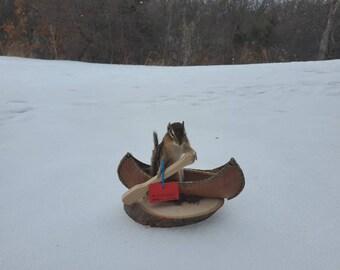 One chipmunk in a canoe