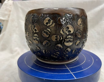 Skull texturized bowl wheel thrown and hand decorated with a bronze like glaze/lined with black glitter glaze stoneware ceramic made is USA