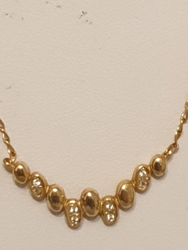 Beautiful choker set and earrings un sterling silver with zircons and 24 carat gold plating exclusive elegant design