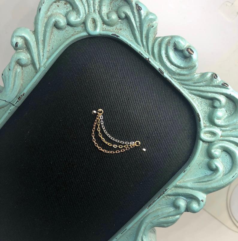 14k Mixed gold Triple hang Piercing chain.