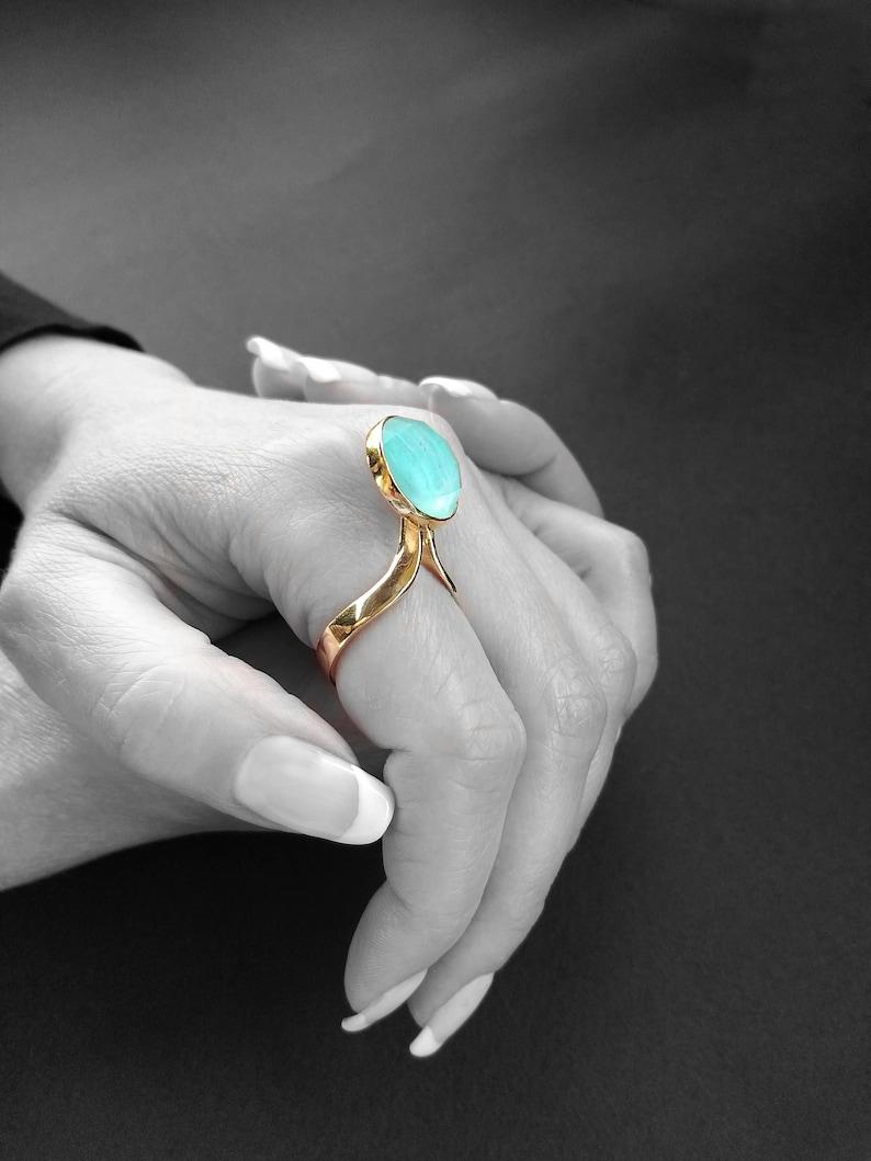 Handmade unique jewelry ring with blue round shaped aquamarine stone