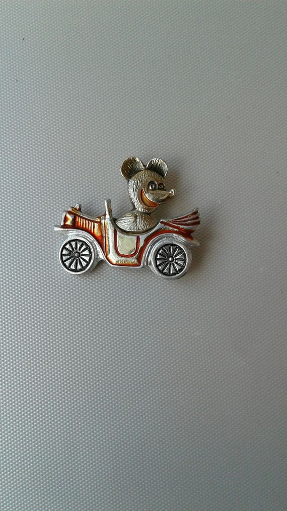 Teddy bear. Icon. Teddy bear on a car. Soviet old