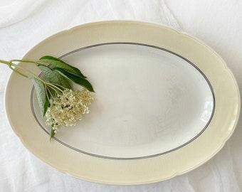 "Large serving platter, creamy white with green rim | Vintage Danish design tableware ""Poul"", Aluminia, Københavns Fajencefabrik"