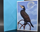 Postcard of a cormorant with the moon in the background.