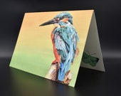 Postcard of a kingfisher with green and orange background