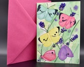 Postcard of coloured butterflies in a lavender field