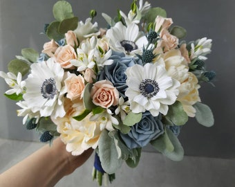 Dusty blue blush and white wedding bouquet
