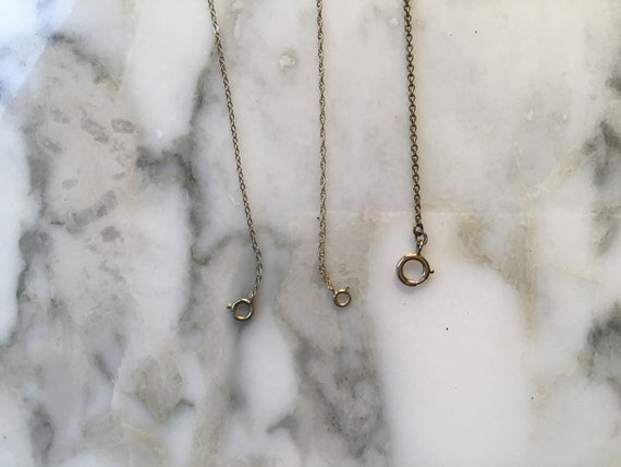 Three 9 carat gold necklace chains.