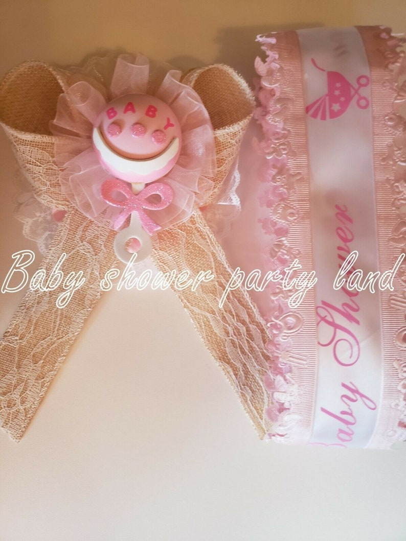 Baby Shower decoration for girl Mom To Be It/'s a Girl Sash Pink With Rattle Ribbon and Corsage