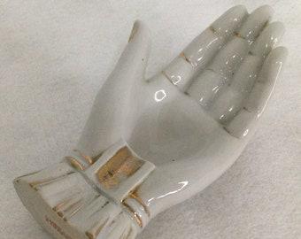 Porcelain gold trimmed hand ashtray