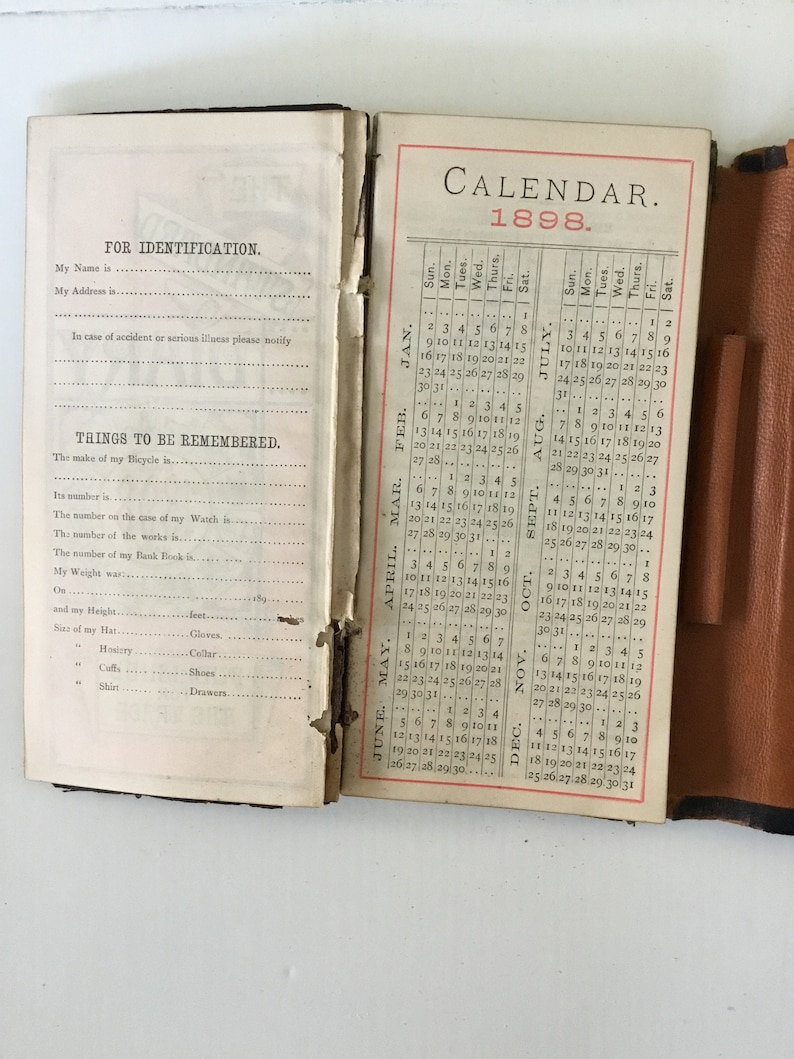 Two antique leather bound items; railroadsteamship wallet and a 1898 calendar diary.