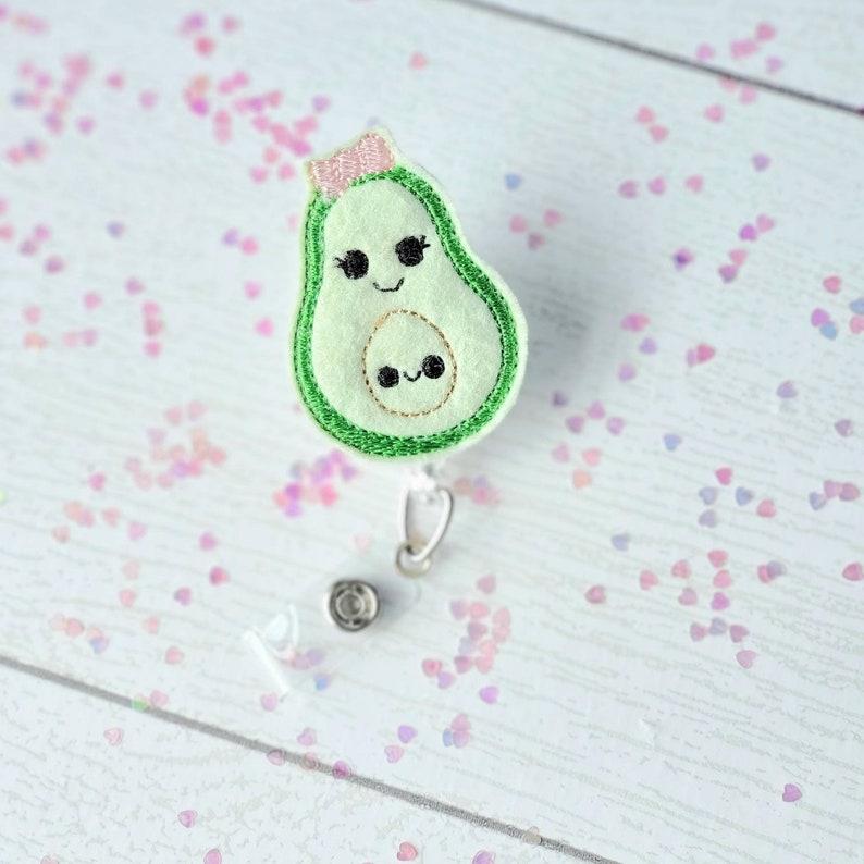 Avocado with baby retractable badge reel clip