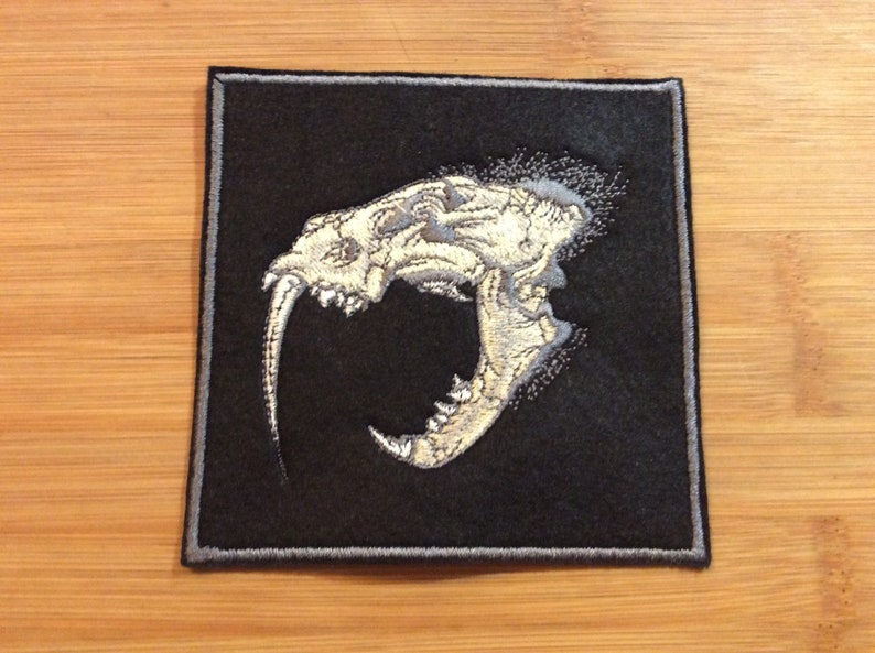Embroidered Sabertooth Tiger Skull Patch SewIron-On by Twistedstitcher 2018 Located in Abbotsford BC Canada