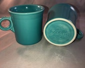Set of 2 Fiestaware Turquoise ( Newer) Tom Jerry coffee mugs with the ring handle. Mint Condition