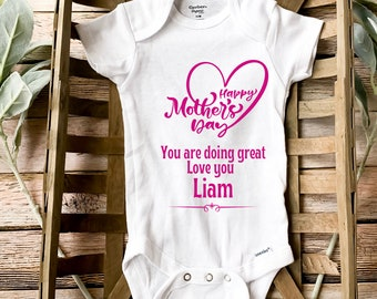 First Mother/'s DayInfant Graphic Onesies\u00aeMom to BePregnancy AnnoucementGift for Mom I call her MOM Onesie\u00ae I Have a Hero