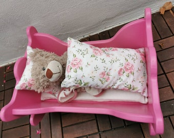 Doll bed / doll cradle with hand-sewn reversible bedlinen