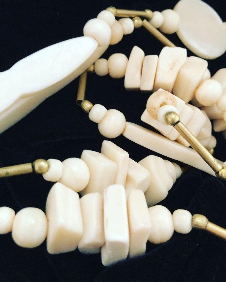Vintage Striking bone necklace and stud earring set.