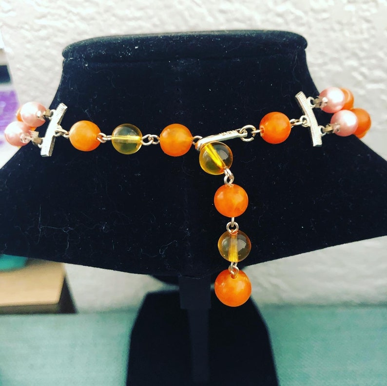 beaded necklace with beautiful oranges and pinks. double strand midcentury Vintage Japanese