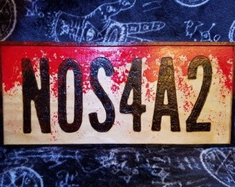 NOS4A2 wood burned plaque with red splash