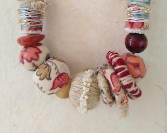 Textile necklace.