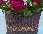 Wicker door basket made of paper vine with a wooden handle.Basket for wall or fronthome decoration.Wicker basket for flowers.