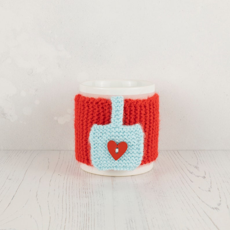 Mug Cozy. Hand-Knitted in Red with Blue 'Tea Bag' image 0