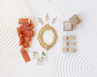 Flat Lay Styling Kit for Photographers , Tan Velvet Ring Box, Orange Silk Ribbon on Wood Spool, White Dish Set, Gold Frame Props