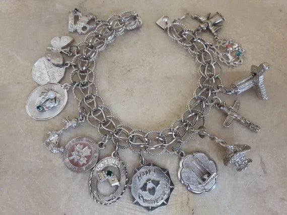 Vintage Sterling Silver Charm Bracelet with 14 Ch… - image 1