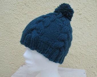 Children's twisted hat in blue alpaca wool