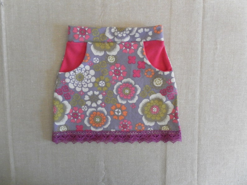 Organic cotton baby skirt with pockets flower patterns image 0