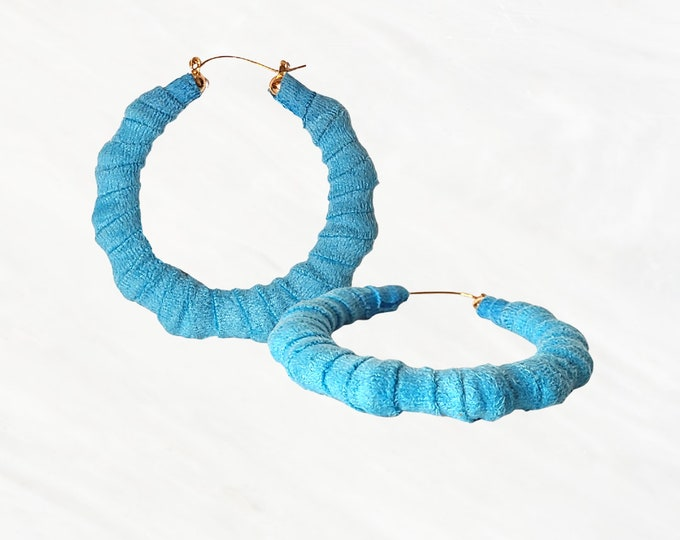 These Blue Bamboo Hoops are Very Soft to The Touch. A Vibrant, Lightweight Earring to Express Yourself Without Saying a word. Baby Blue!