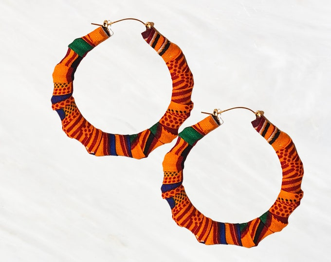 """African """"Kente Cloth"""" Bamboo Hand-wrapped Hoops are Bright and Bold. Fabric Can Pretty Much Be Worn With Anything. Wax Coated For Protection"""