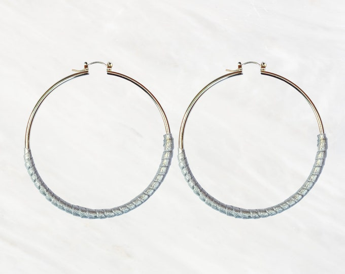 Silver Skinny Hoop Style Earrings Half Wrapped in Faux Leather. Thin & Lightweight. Dress Up or Down. Either Way It's Perfect For Everyday.