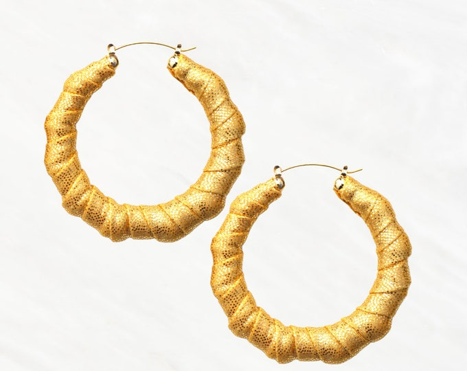 Our Bamboo Hoop Style Liquid Gold Earrings are a Queens Must Have. These are a Classic 90's Hoop, but with a 2021 Twist!