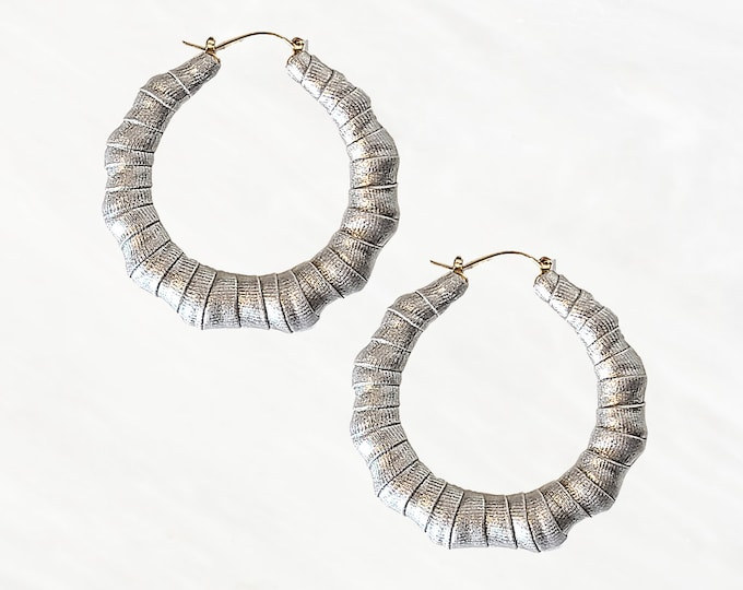 Silver Classic Bamboo Hoops are Surely a Bold Hoop To Own. This Lightweight Style Easily Transitions From Day To Night. A Queens Must Have!