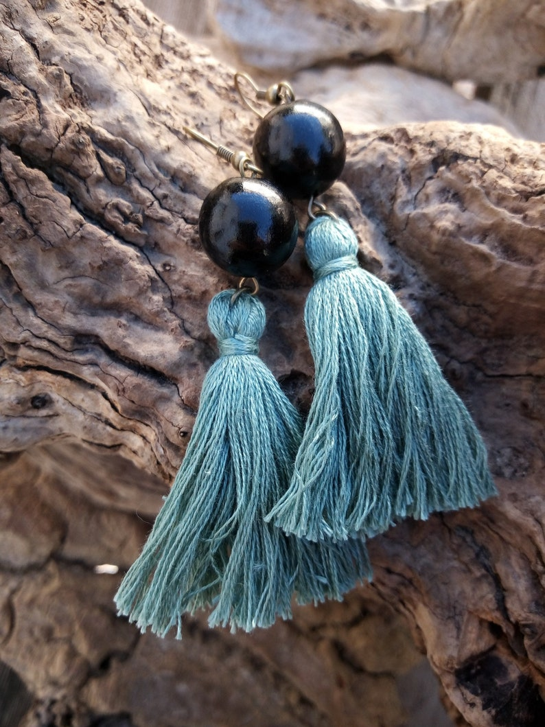 Bronze earrings with wooden beads and cotton pom poms  Bronze earrings with wooden beads and cotton tassels