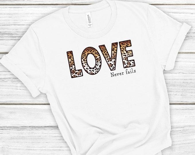 Love Never Fails,  Leopard Print, Women's Short Sleeve Tee, Christian Tee, Gift For Her, Valentine's Shirt, 1 Corinthians 13, Bible Verse
