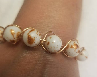 Copper and white beads with copper wire wrapped around each bead. Comes with matching earrings. 20.99 Free Shipping Handling. Size 6, 7 or 8