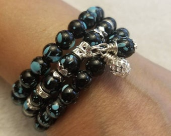Black and turquoise bead with silver dangles. Comes with matching earrings 19.99 Free Shipping and Handling. Size 6, 7 or 8