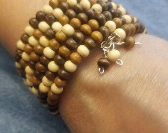 5 MM beaded cuff Wooden Boho bracelet, with matching earrings. 18.99 Comes in size 6, 7 or 8