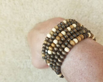 Single wooden beaded bracelets    Can wear 1, 2, 3, 4, 5 or all 6 at a time. Solid brown or multi colors. 6 for 20 dollars or 4 dollars each