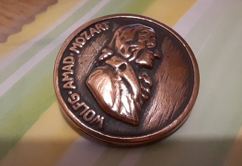 1 antique mozart music composer head button Copper fitted 1 inch diameter.