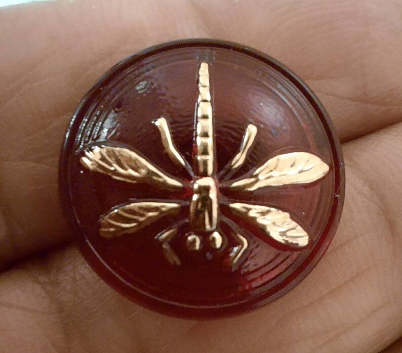 1.8 cm. 1 small dragonfly on red glass button