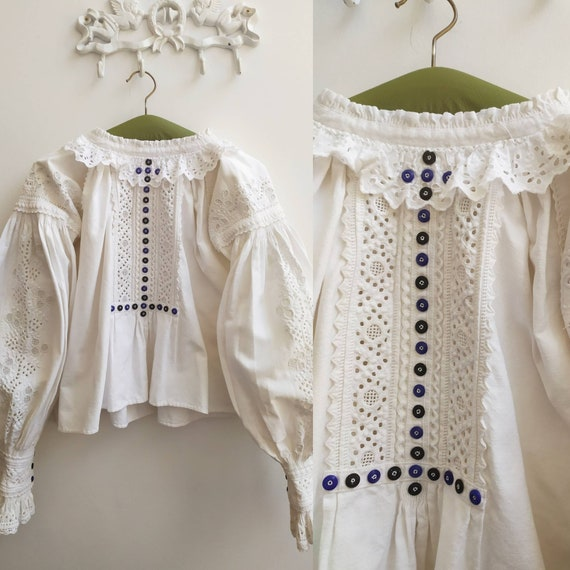 Antique Romanian blouse with floral embroidery and