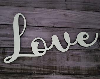Lettering Love in wood in white
