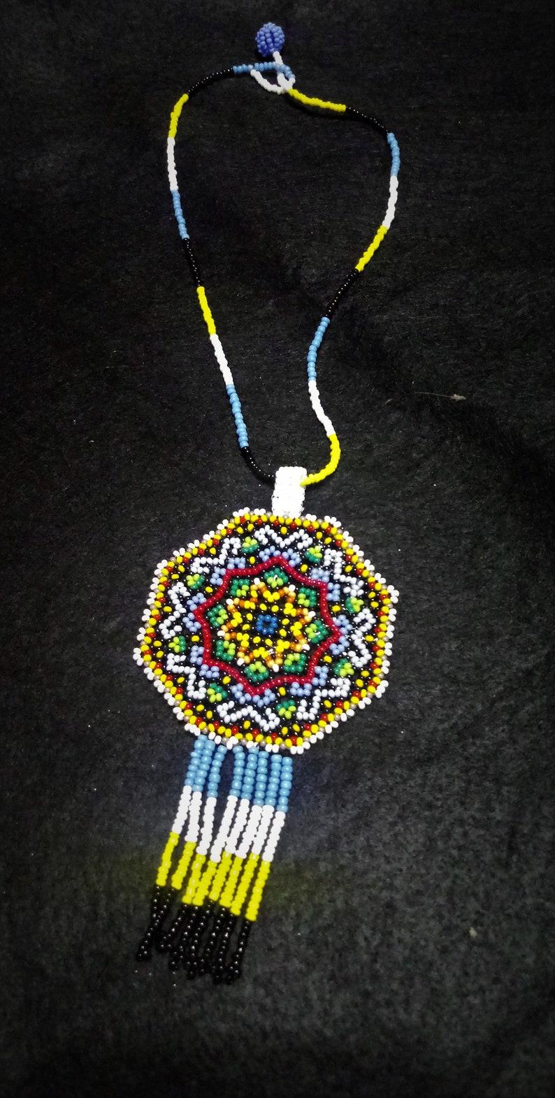 Huichol style mandala star