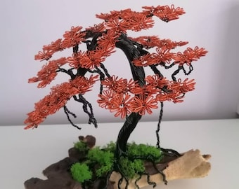Bonsai wire tree sculpture attached to wood. Tree ornament.